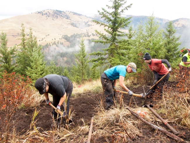 Laura Solem, Cathy Fischer, and Liz Higgins said they volunteered to help build the new Spur trail on National Public Lands to give back to the public lands they use every day to get outside, Sept. 30, 2017.