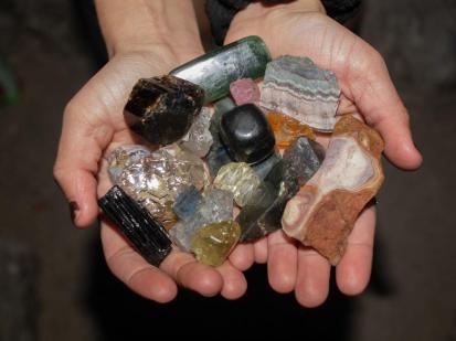 Lindsey Henderson holds her collection of crystals including Labradorite which shines blue-green.